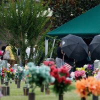 After the viewing and funeral service, mourners gather at the burial site for Kimberly Morris, June 16, 2016 in Kissimmee, Florida. (Drew Angerer/Getty Images)