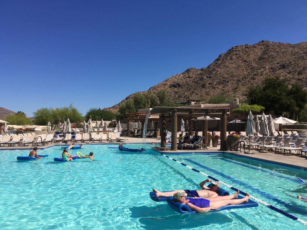 Hotel guests cool off at the pool at the JW Marriott Scottsdale Camelback Inn Resort and Spa in Paradise Valley, Ariz., on Sunday, June 19, 2016. States in the Southwest are in the midst of a summer heat wave as a high pressure ridge bakes Arizona, California and Nevada with extreme, triple-digit temperatures. (Anna Johnson/AP)