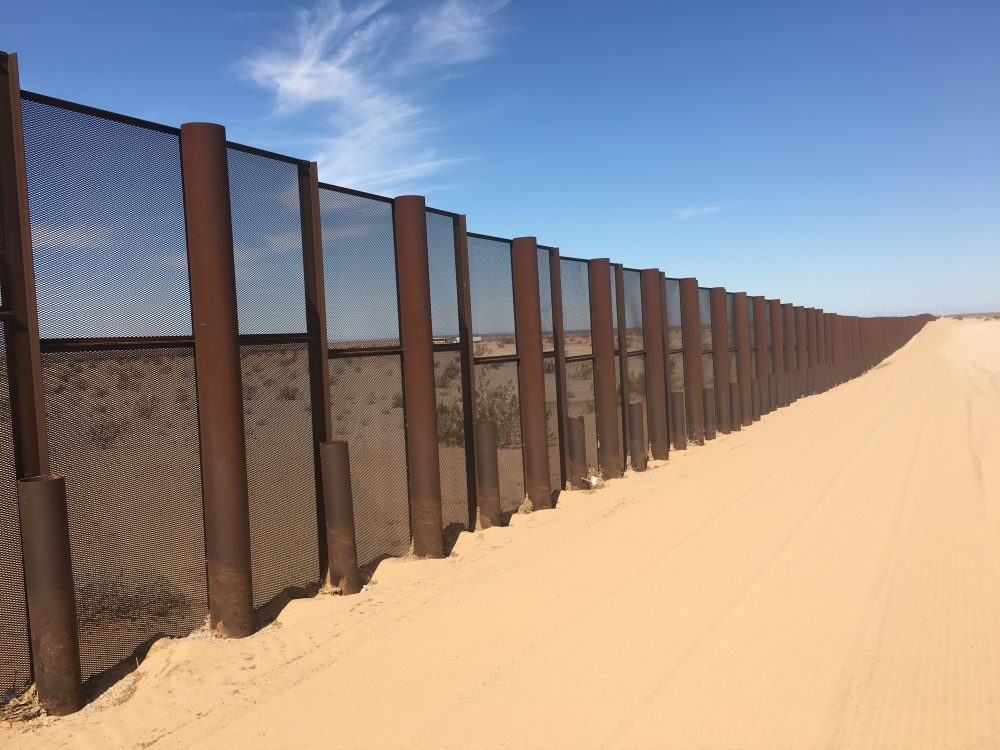 The border fence runs about $6.5 million per mile. It's worked to staunch the flow of illegal entries by Mexicans but now Yuma is seeing a rise in Central Americans crossing this fence in search of asylum. (Michel Marizco/KJZZ)