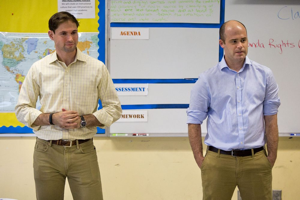 Attorneys Nate Koslof, left, and Clark Freeman lead the Law Day session at Lilla Frederick Middle School. They said they were impressed with the students questions about Miranda rights. (Jesse Costa/WBUR)