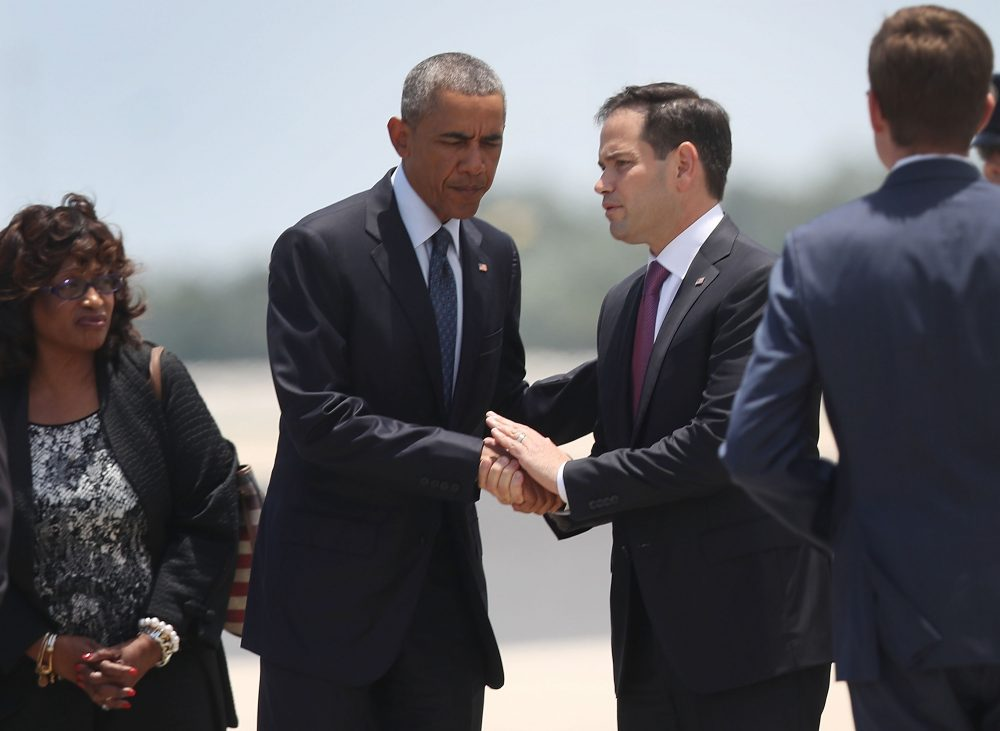 President Barack Obama shakes hands with Sen. Marco Rubio (R-FL) after they arrive at the Orlando International Airport to visit with family and community members after the attack at the Pulse gay nightclub where Omar Mateen killed 49 people on June 16, 2016 in Orlando, Florida. The mass shooting on June 12th killed 49 people and injured 53 others in what is the deadliest mass shooting in the country's history.  (Joe Raedle/Getty Images)