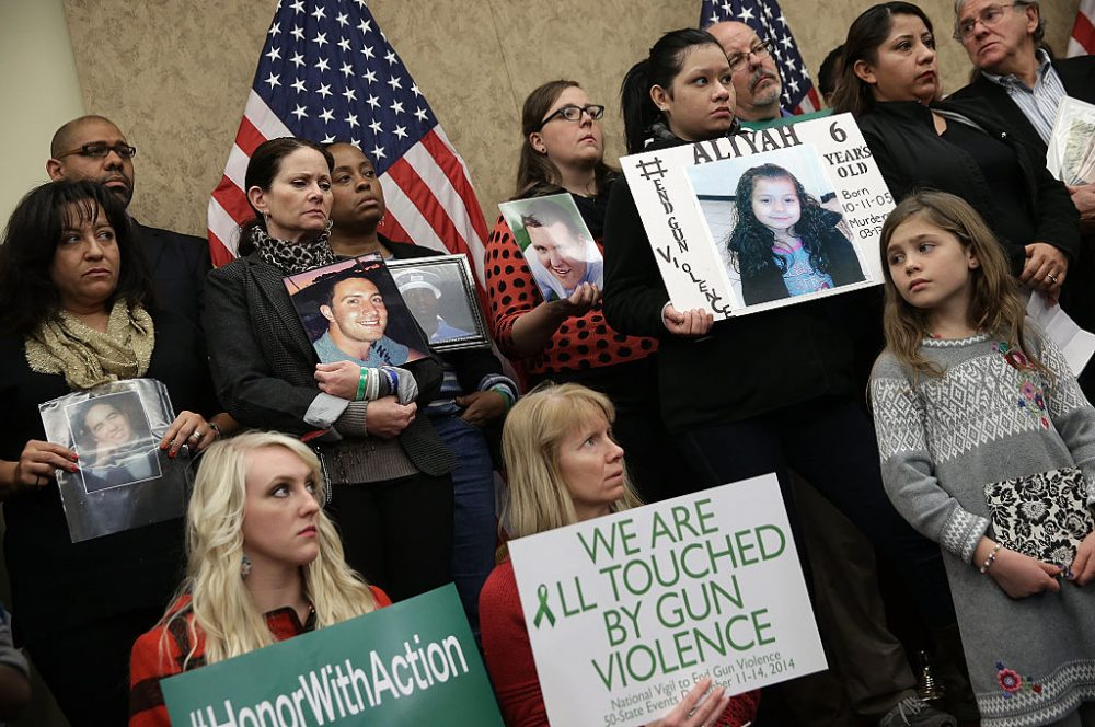 Family members who have lost loved ones to gun violence gather with members of Congress during a press conference four days before the second anniversary of the shooting at Sandy Hook Elementary School December 10, 2014 in Washington, DC.  (Win McNamee/Getty Images)