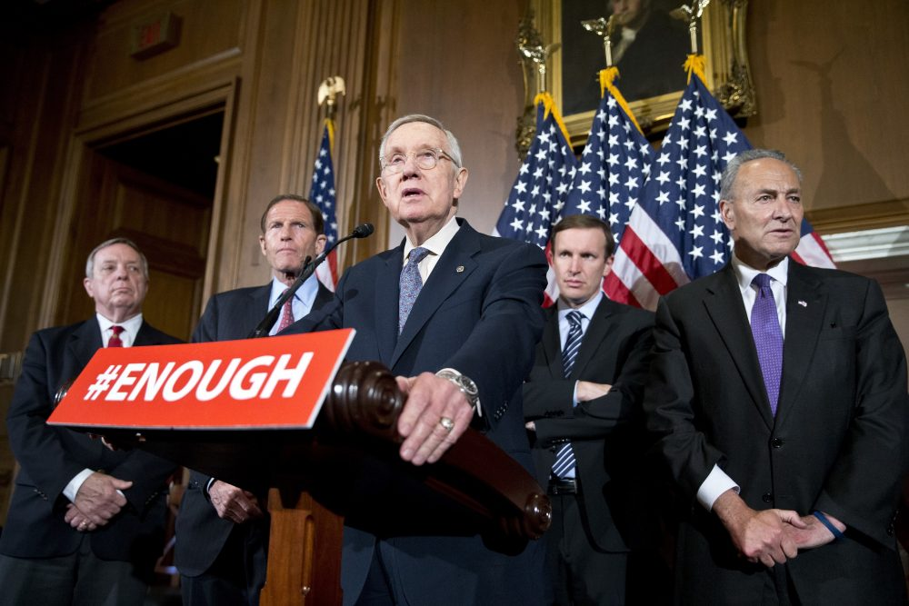 Sen. Richard Durbin, D-Ill., left, Sen. Richard Blumenthal, D-Conn., Sen. Chris Murphy, D-Conn., and Sen. Charles Schumer, D-N.Y., listen as Minority Leader Harry Reid of Nevada, center, speaks during a media availability, on Capitol Hill, Monday.  (Alex Brandon/AP)
