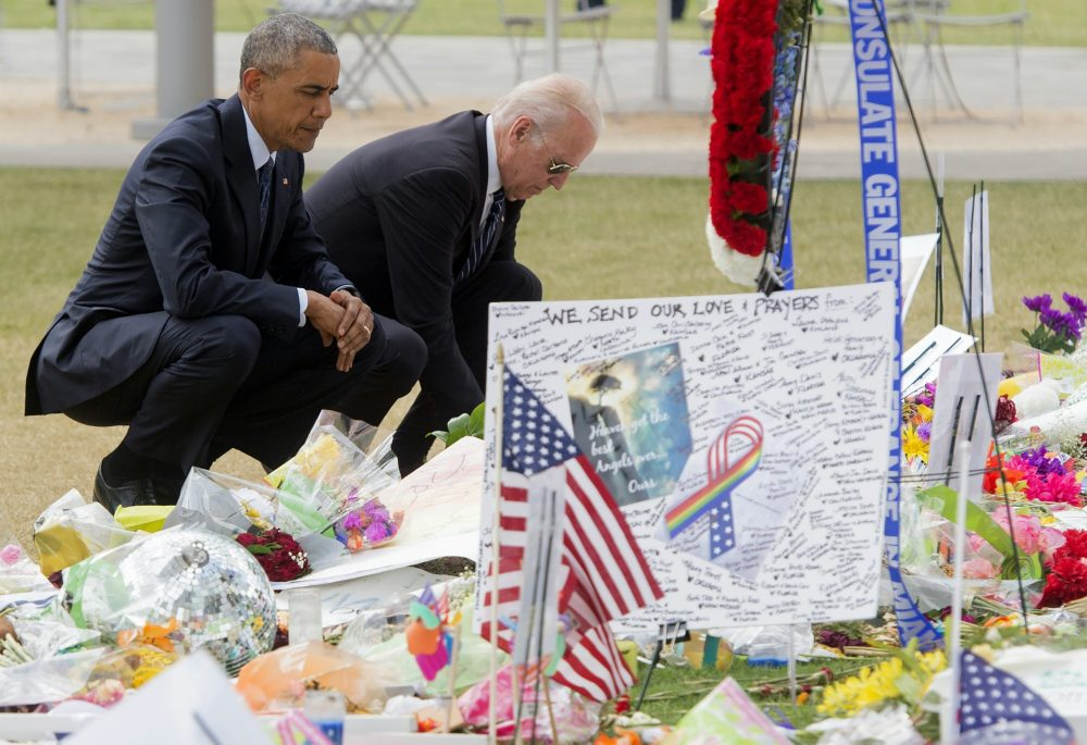 President Barack Obama and Vice President Joe Biden place flowers for the victims of the mass shooting at a gay nightclub Sunday at a memorial at the Dr. Phillips Center for the Performing Arts in Orlando, Florida, June 16, 2016. (Saul Loeb/AFP/Getty Images)