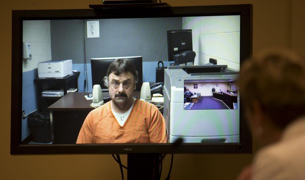 Wendell Noyes appears via a video arraignment from the county jail in Stewartstown, New Hampshire, as prosecutor Jane Young, right, listens in district court in Berlin on Tuesday. (Jim Cole/AP, Pool)