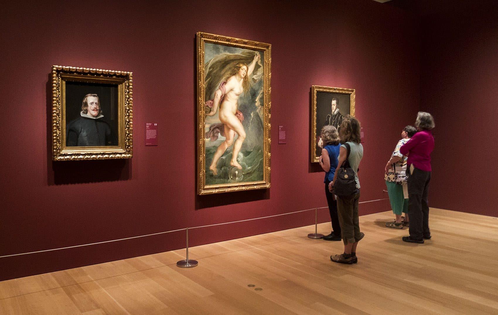 "Museum visitors examine Peter Paul Rubens's ""Fortuna"" -- part of the ""Spendor, Myth, and Vision: Nudes from the Prado"" exhibit at the Clark Art Institute. (Andrea Shea/WBUR)"