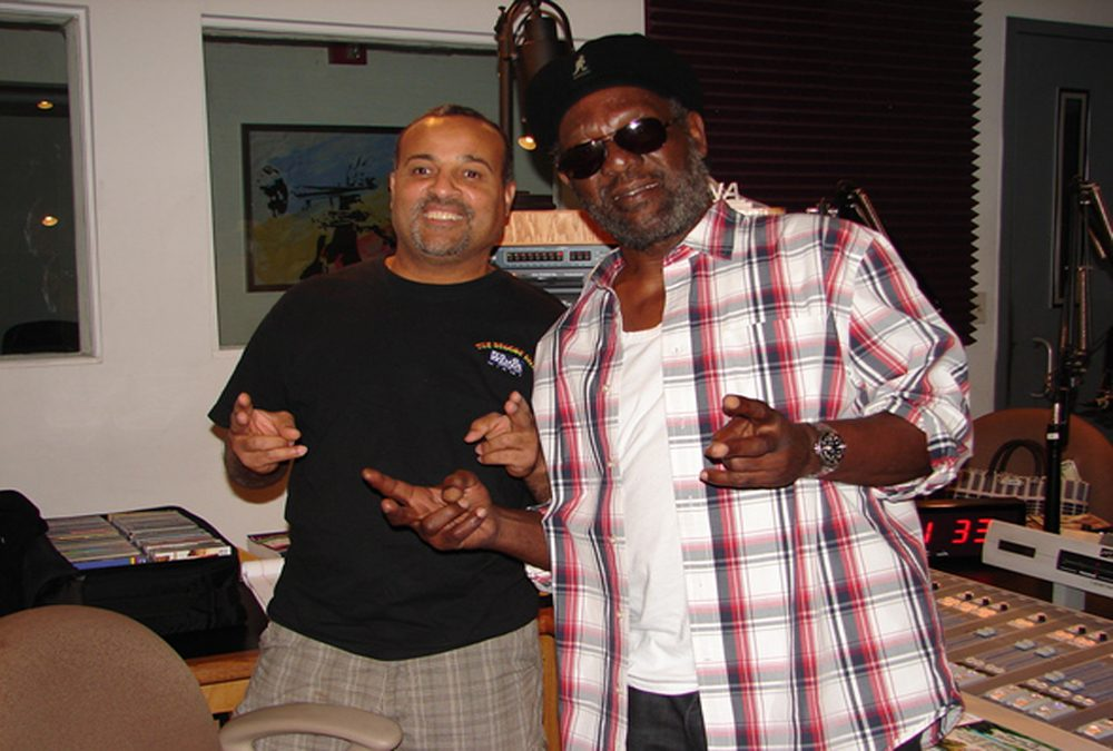 "DJ Howard ""Flagga"" Duperly, right, with reggae artist Bunny Rugs. (Natasha Moves Reggae)"
