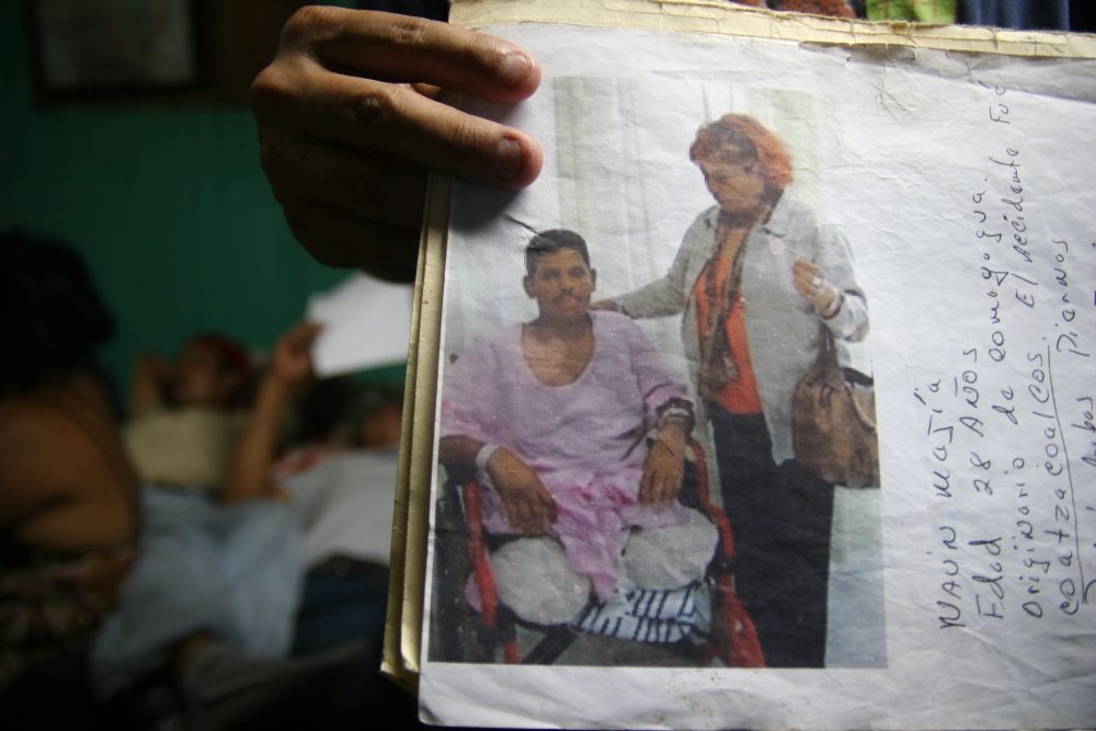 Untold numbers of Central American migrants have lost limbs, or their life, after falling, or being thrown off cargo trains. Mexico says it has raided the trains to remove and protect migrants from gangs that control the trains through extortion and violence. (Lorne Matalon/Fronteras)