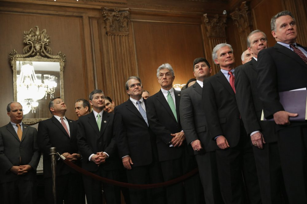 Republican members of the House of Representatives line up to watch Speaker of the House Paul Ryan (R-WI) sign legislation to repeal the Affordable Care Act, also known as Obamacare, and to cut off federal funding of Planned Parenthood during an enrollment ceremony in the Rayburn Room at the U.S. Capitol January 7, 2016 in Washington, DC. President Barack Obama has promised to veto the bill.  (Chip Somodevilla/Getty Images)
