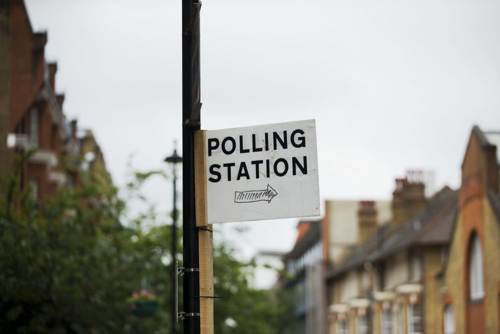 A sign points towards a referendum polling station in London, Wednesday, June 22, 2016. Britain votes whether to stay in the European Union in a referendum on Thursday. (Matt Dunham/AP)