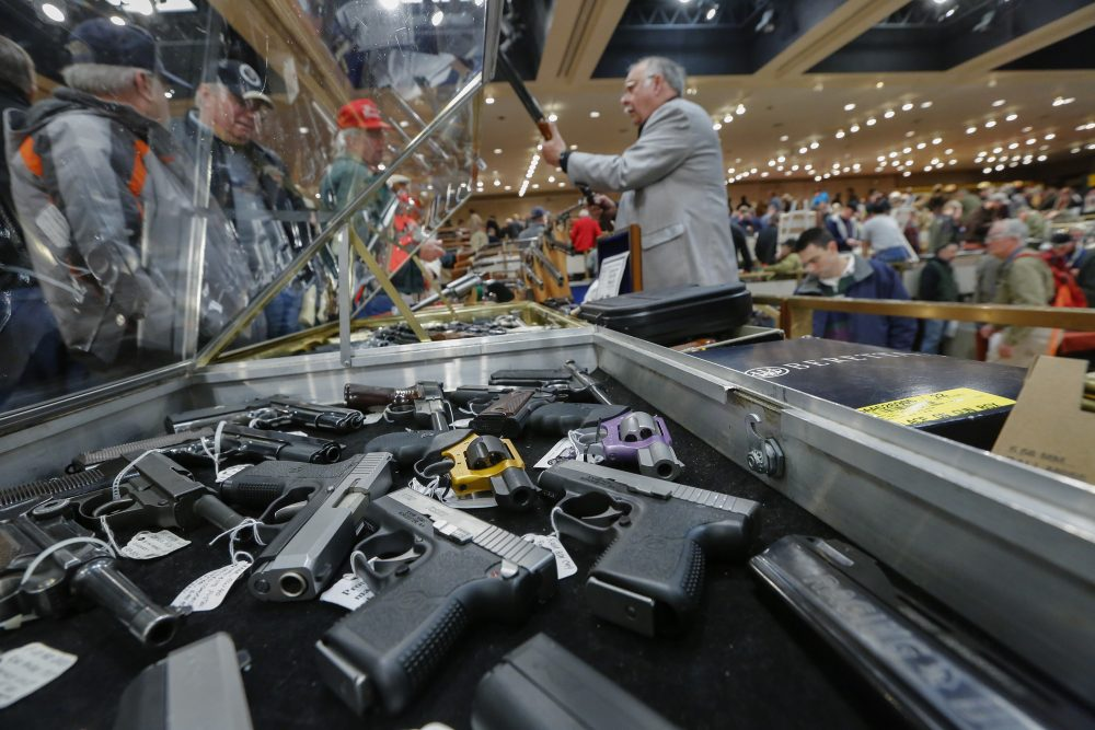 Guns on display at the annual New York State Arms Collectors Association Albany Gun Show in 2013. Without federal action on gun control, it falls to the states to create their own laws, or not. (Philip Kamrass/AP File)