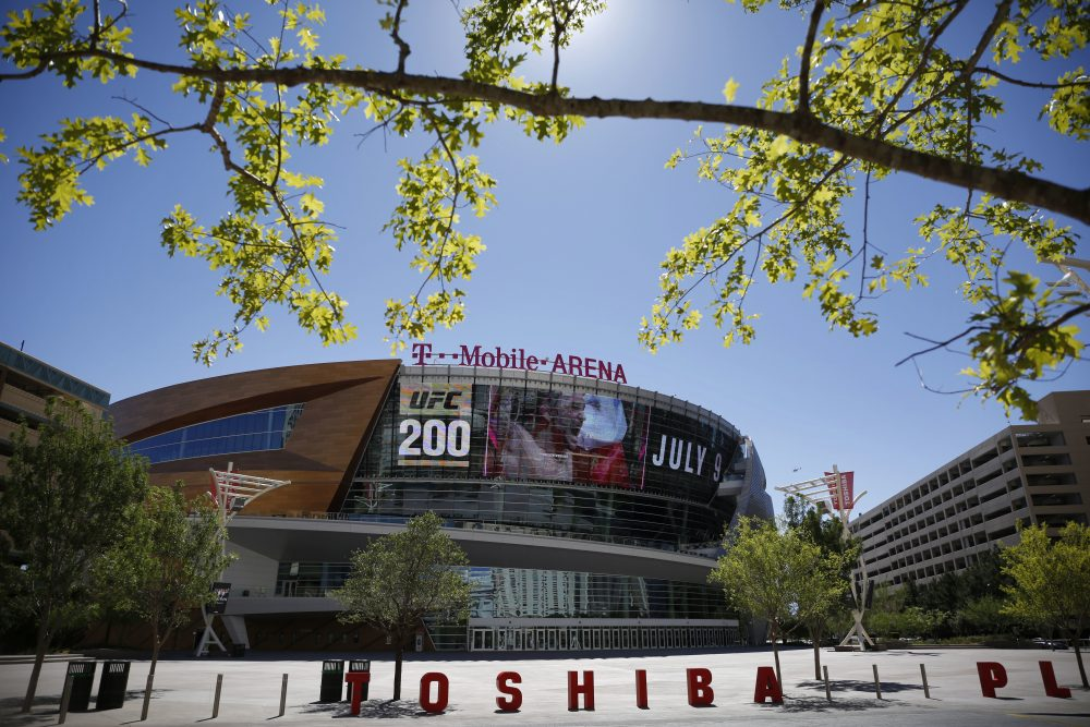 In this June 17, 2016 photo, an advertisement plays on a screen at the T-Mobile Arena in Las Vegas. A National Hockey League plan to expand to Las Vegas is being cheered by fans and backers of a years-long effort to get a pro sports franchise in Sin City, but hockey will have to elbow into a crowded entertainment lineup featuring casino games, celebrity shows, Cirque du Soleil productions and pulsing nightclubs – not to mention boxing matches, UFC fights and events like the National Finals Rodeo. (John Locher/AP)