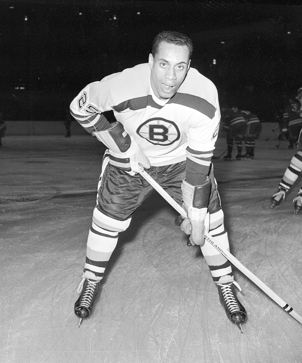 25-year-old left wing Willie O'Ree, the first black player of the National Hockey League, warms up in his Boston Bruins uniform, prior to a game with the New York Rangers at Madison Square Garden in New York City on November 23, 1960. (AP)