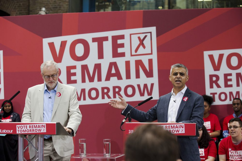 "London Mayor Sadiq Khan, right, makes an address flanked by the leader of Britain's opposition Labour Party Jeremy Corbyn during a European Referendum ""Remain"" rally in London, Wednesday, June 22, 2016. (AP Photo/Matt Dunham)"