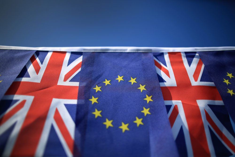 The European Union and the Union flag sit together on bunting on March 17, 2016 in Knutsford, United Kingdom. (Christopher Furlong/Getty Images)