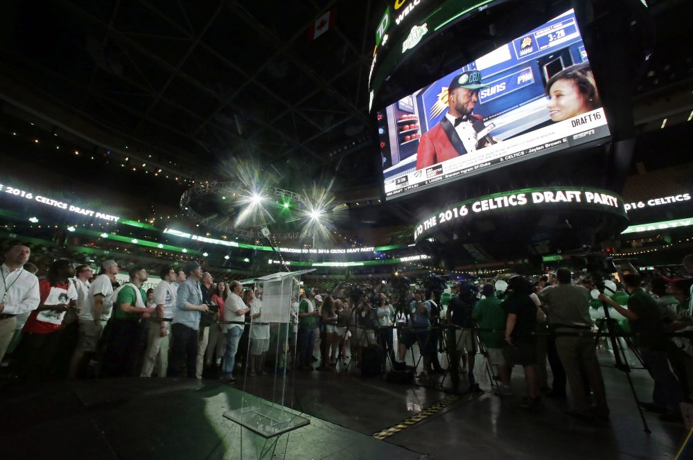 Fans watch as Jaylen Brown appears on a big screen at TD Garden Thursday night after being selected third overall by the Celtics. (Elise Amendola/AP)