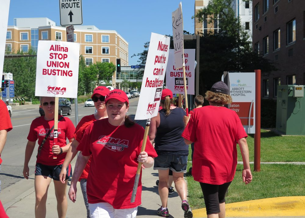 Registered nurse Kellie Weikle protests outside Abbott Northwestern Hospital in Minneapolis, Minnesota on June 23, 2016. (Courtesy/Mark Zdechlik/MPR)