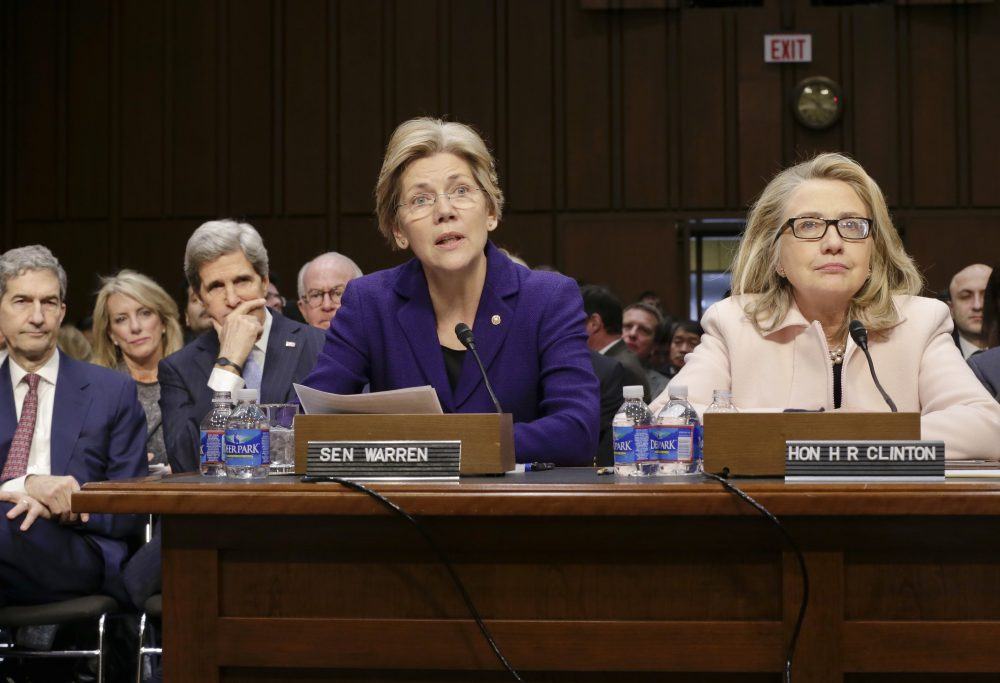 Sen. Elizabeth Warren will join Hillary Clinton on the campaign trail in Ohio on Monday. The senator, pictured here in the center, sits next to Clinton, right, who spoke at John Kerry's confirmation hearing to become secretary of state in 2013. (J. Scott Applewhite/AP)