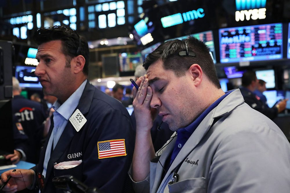 Traders work on the floor of the New York Stock Exchange (NYSE) following news that the United Kingdom has voted to leave the European Union on June 24, 2016 in New York City. The Dow Jones industrial average quickly fell nearly 500 points on the news with markets around the globe plunging. (Spencer Platt/Getty Images)