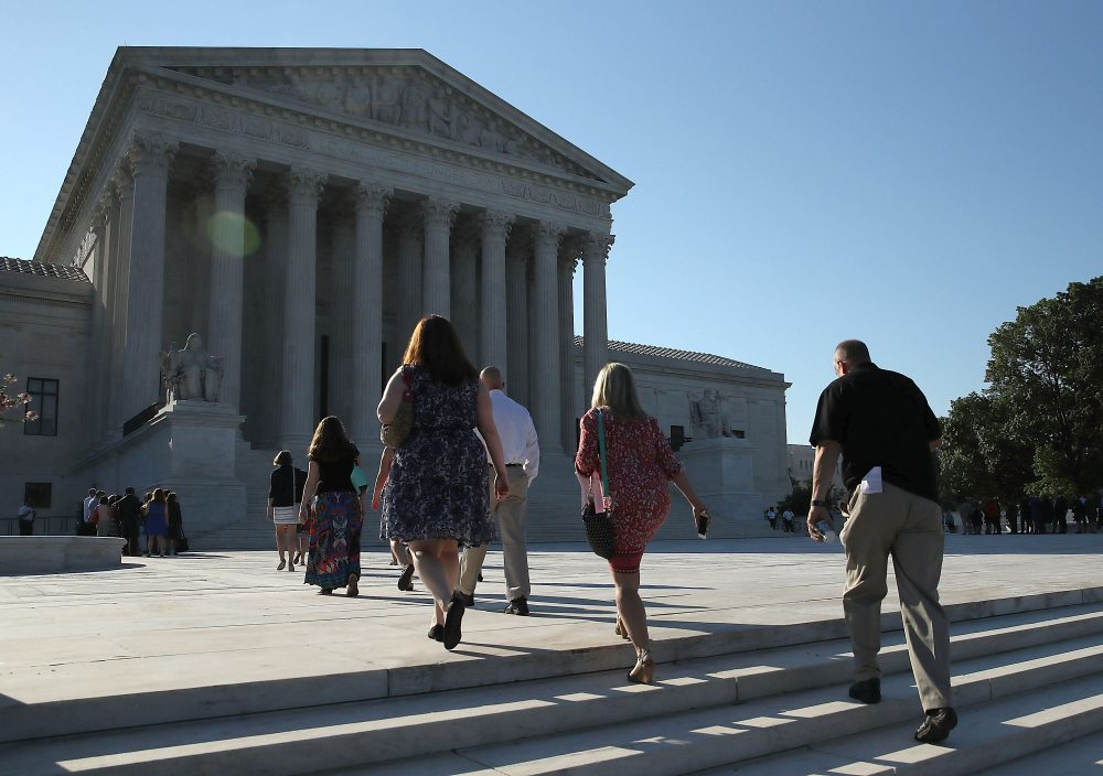 People walk up to the U.S. Supreme Court building June 20, 2016 in Washington, DC. The high court still has four decisions to hand down before their summer break next week.  (Mark Wilson/Getty Images)