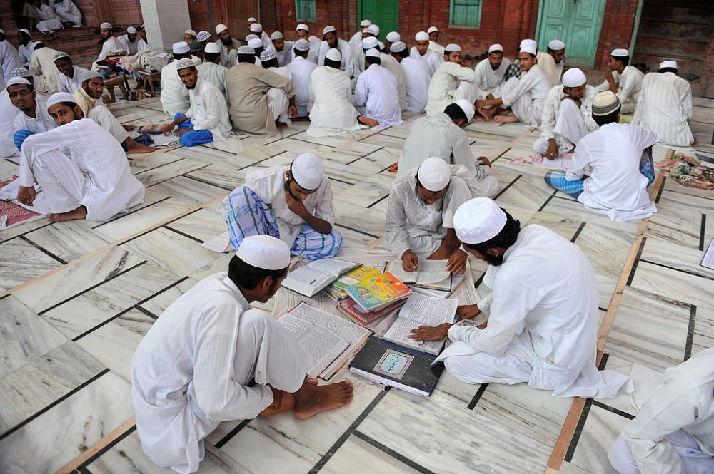 In this picture taken on September 7, 2011 Muslim students prepare for their entry exams on campus of the Darul Uloom Deoband school of Islam. The 145-year-old Darululoom Deoband situated in the sleepy town of Deoband in north Indian state of Uttar Pradesh is acknowledged as the spiritual home for conservative Deobandi school of Islam and their methodology is followed by religious schools in Asia, Middle East, Britain and the United States. (Sajjad Hussain/ Getty Images)