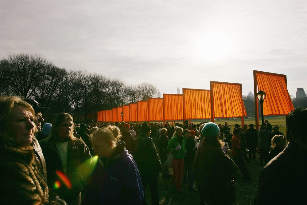 "People walk through the Christo's art exhibit ""The Gates,"" in Central Park, 2005, New York City. (Spencer Platt/Getty Images)"