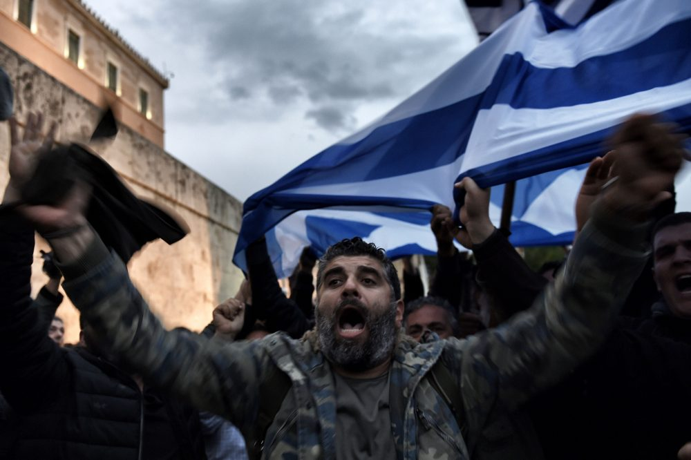 "Farmers demonstrate outside the Greek parliament during a protest against pension reform and tax issues, on February 12, 2016. Fears that Greece will exit the eurozone, a ""Grexit"", could revive if Greek authorities do not come up with ""credible"" reforms, notably on pensions, a senior IMF official said February 11. (ARIS MESSINIS/AFP/Getty Images)"