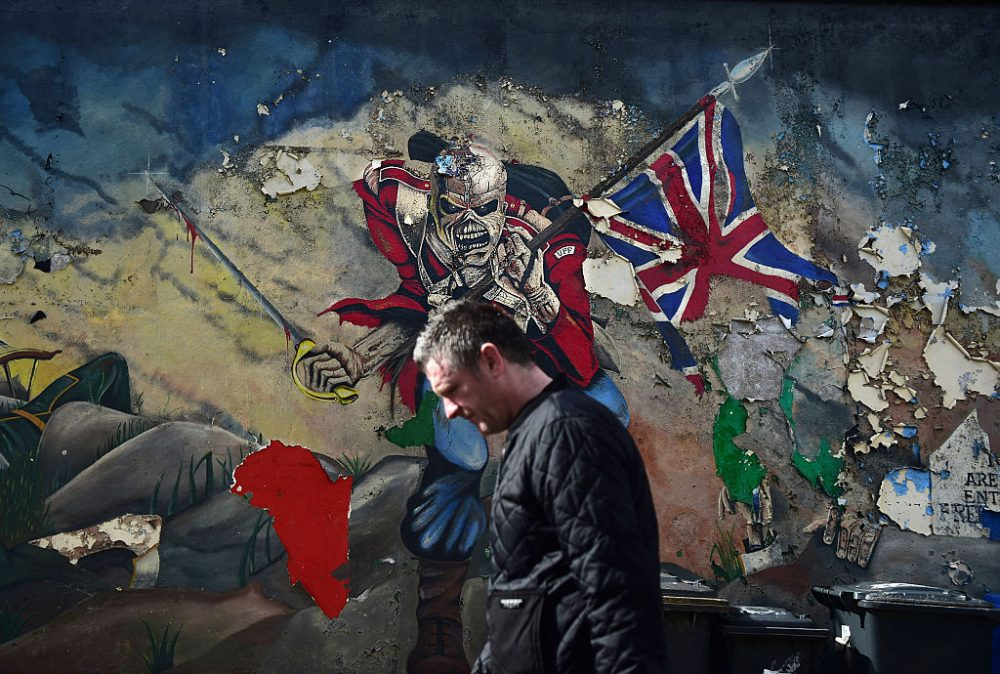 A man walks past a mural marking unionist territory on May 4, 2016 in Londonderry, Northern Ireland. The city of Londonderry is situated on the border between the north and south of Ireland. (Charles McQuillan/Getty Images)