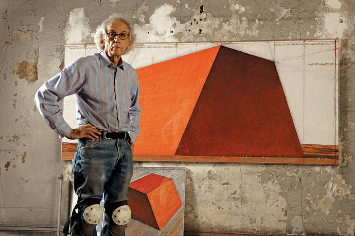 "Christo in his studio with a preparatory drawing for ""The Mastaba,"" 2012 (Wolfgang Volz/Christo)"