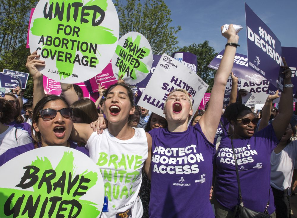 Abortion rights activists rejoice in front of the Supreme Court in Washington Monday as the justices struck down the strict Texas anti-abortion restriction law known as HB2. (J. Scott Applewhite/AP)