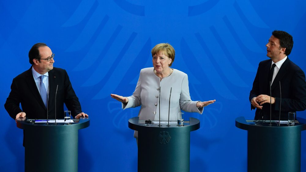 (L-R) French President Francois Hollande, German Chancellor Angela Merkel and Italy's Prime Minister Matteo Renzi address a press conference ahead of talks following the Brexit referendum at the chancellery in Berlin, on June 27, 2016. (John MacDougall/AFP/Getty Images)