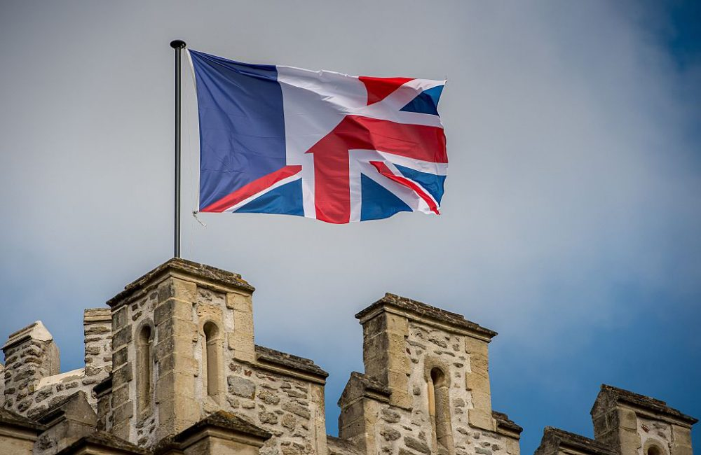 A photo taken on June 24, 2016 shows an amalgamation of the French and United Kingdom flag flying from a flagpole on the top of the castle of Hardelot, the cultural center of the Entente Cordiale (the colonial-era promise of cross-channel friendship between Britain and France) in Neufchatel-Hardelot, northern France.  (Philippe Huguen /AFP/Getty Images)