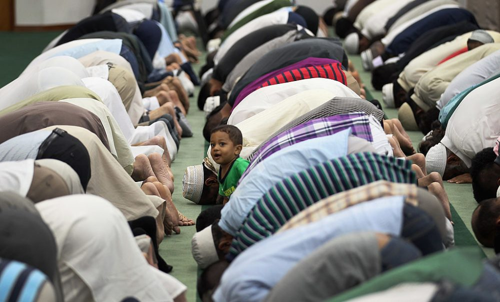 Hyder Huzri, 2, waits as his father and others pray during an evening prayer on the first day of Ramadan at the Islamic Center of Greater Miami on August 1, 2011 in Miami, Florida. (Joe Raedle/Getty Images)