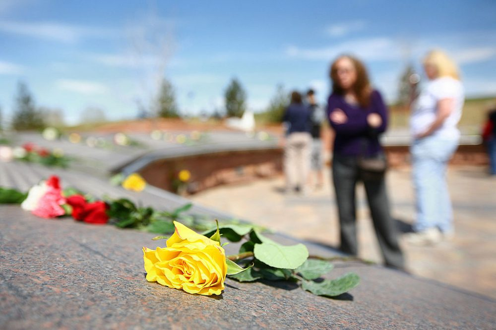 A yellow rose lies on the Columbine Memorial on the 10-year anniversary of the Columbine High School shootings at the Columbine Memorial Park April 20, 2009 in Littleton, Colorado. (Marc Piscotty/Getty Images)