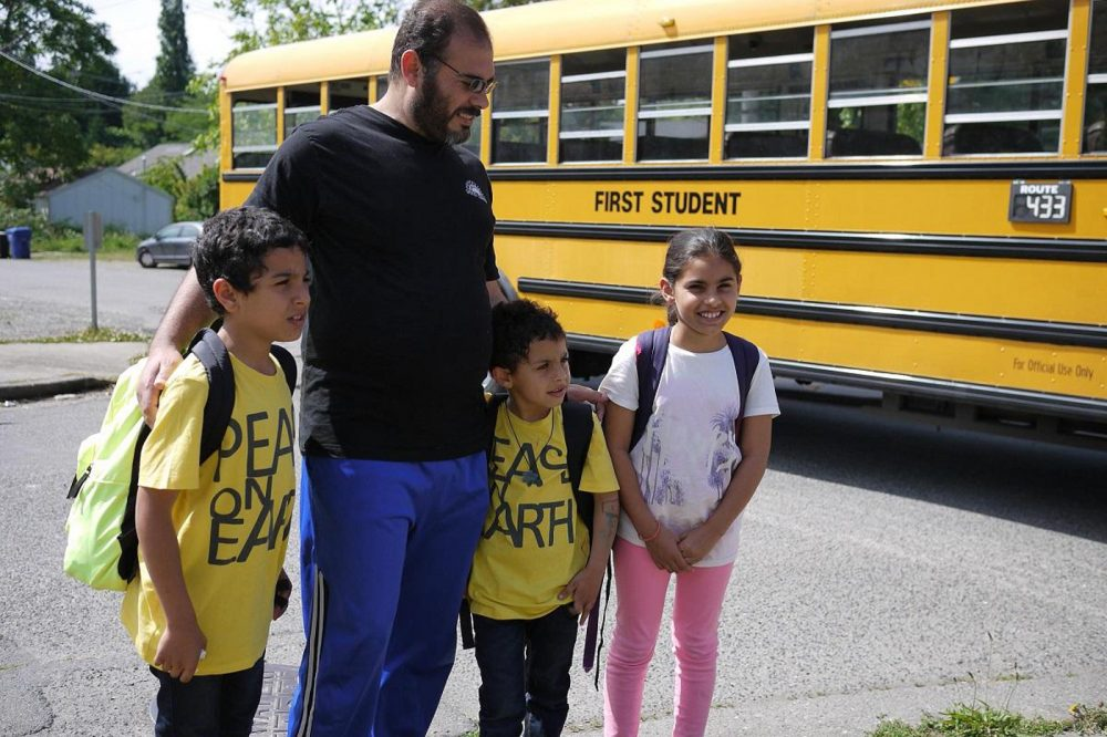 Bassam Alhamdan, father of six, meets his kids at the bus stop every afternoon. (Liz Jones/KUOW)