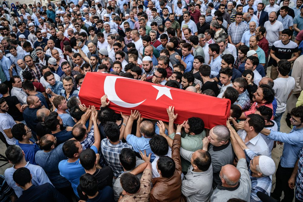People carry a coffin covered with Turkish national flag of suicide attack victim Hamidullah Safar on June 30, 2016 in Istanbul during his funeral two days after a suicide bombing and gun attack targeted Istanbul's airport, killing at least 36 people. (Ozan Kose/AFP/Getty Images)