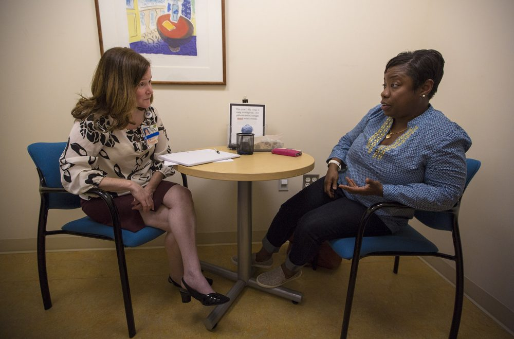 Marcia Chesterfield meets with her clinical social worker, Lara Sullivan, during a face-to-face check-in. (Jesse Costa/WBUR)
