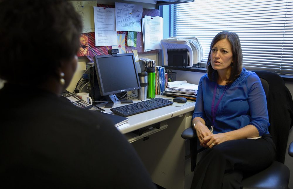Social worker Cynthia Kennedy, clinical coordinator of the Homicide Support Services Project at Beth Israel Deaconess Medical Center, speaks with Worrell. (Robin Lubbock/WBUR)