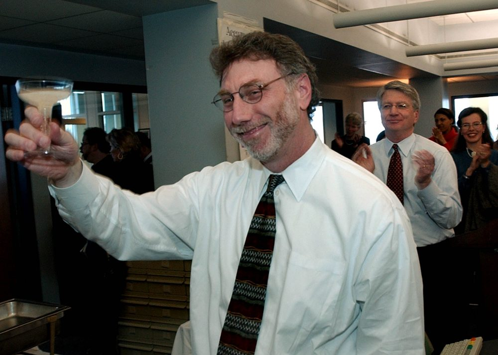 Then Boston Globe editor Martin Baron toasts reporters in the newsroom after the newspaper was honored as a recipient of a Pulitzer Prize in 2003.  (Charles Krupa/AP)