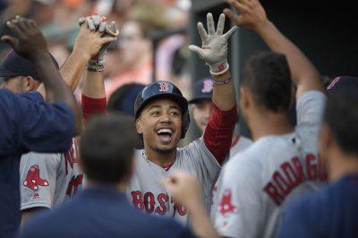 Boston Red Sox' Mookie Betts celebrates the first of three home runs ilast night against the Baltimore Orioles. (Nick Wass/AP)