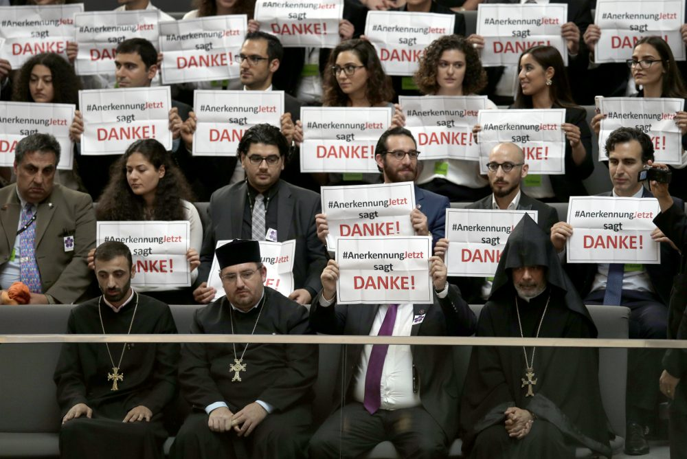 "Germany has become the latest nation to recognize the Armenian Genocide. Nir Eisikovits and Timothy Phillips call on three more -- the U.S., Britain and Israel -- to follow suit, regardless of the diplomatic or geopolitical fallout. Pictured: Guests hold posters of the 'recognition now' organization reading ""RecognitionNow says Thank you"" during a meeting of the German Federal Parliament, Bundestag, in Berlin, Germany, Thursday, June 2, 2016. The German Parliament voted in favor of labeling the killings of Armenians by Ottoman Turks a century ago as genocide. (Michael Sohn/AP)"
