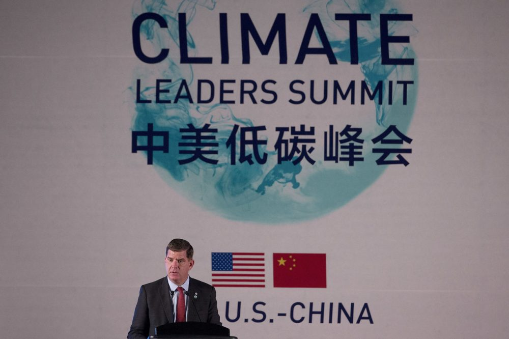 Boston Mayor Martin Walsh speaks at the U.S.-China Climate-Smart/Low-Carbon Cities Summit in Beijing on Tuesday. Walsh and Secretary of State John Kerry announced that Boston will host the summit next year. (Andy Wong/AP/Pool)