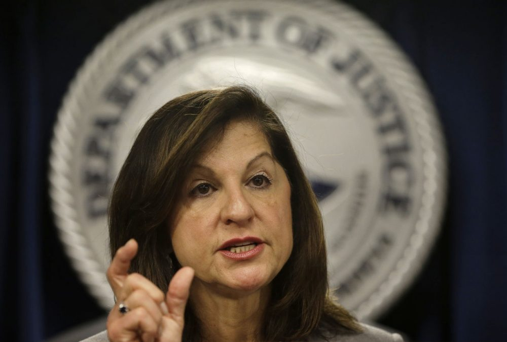U.S. Attorney Carmen Ortiz responds to questions during a news conference in Boston. (Steven Senne/AP)