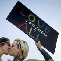 Kari Hong: The Pulse nightclub victims died in a space that was more sacred than what the word nightclub conveys. Pictured: Adriana Kelley, right, kisses Tiffany Findley, both of Orlando, as they stand with supporters outside the visitation for a Pulse nightclub shooting victim, Wednesday, June 15, 2016, in Orlando, Fla. (David Goldman/AP)