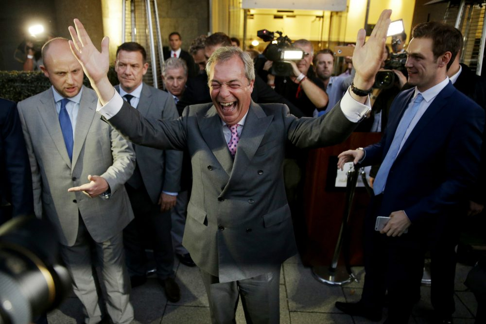 "Nigel Farage, the leader of the UK Independence Party celebrates and poses for photographers as he leaves a ""Leave.EU"" organization party for the British European Union membership referendum in London, Friday, June 24, 2016. (Matt Dunham/AP)"