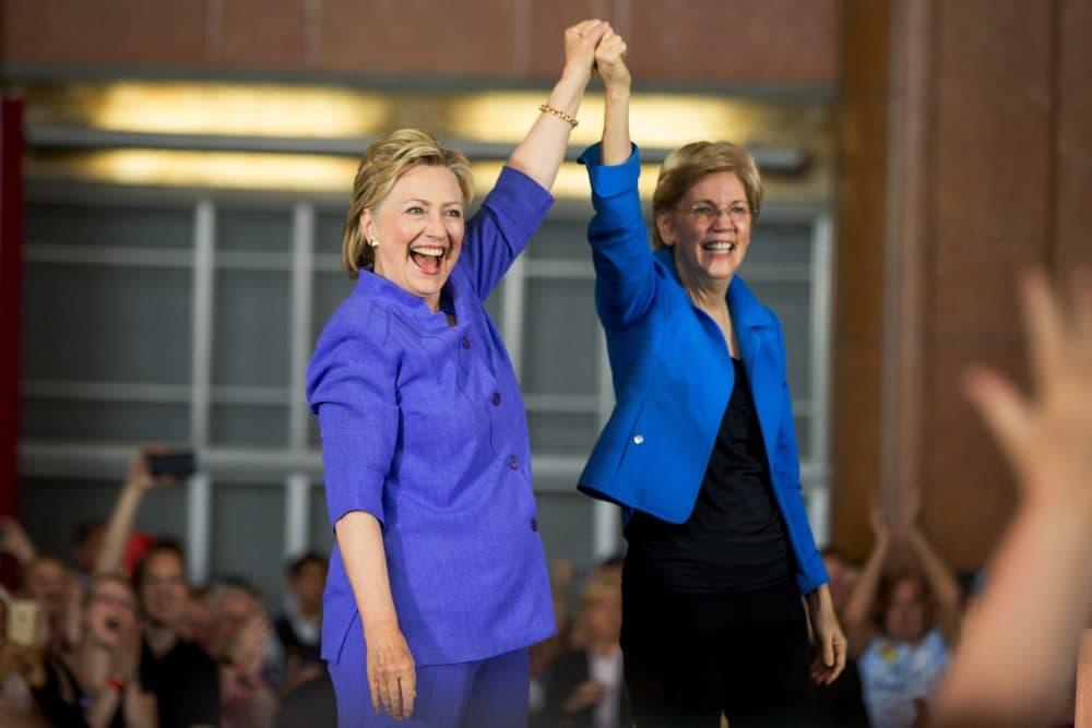 Democratic presidential candidate Hillary Clinton, accompanied by Sen. Elizabeth Warren, D-Mass., arrives to speak  in Cincinnati, Monday, June 27, 2016. (Andrew Harnik/AP)