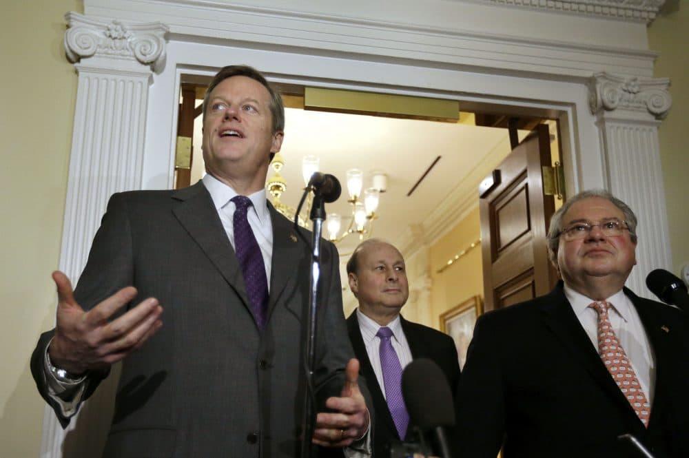 From left: Republican Gov. Charlie Baker, Democratic Senate President Stanley Rosenberg and Democratic House Speaker Robert DeLeo, during a 2015 news conference at the State House (Steven Senne/AP)