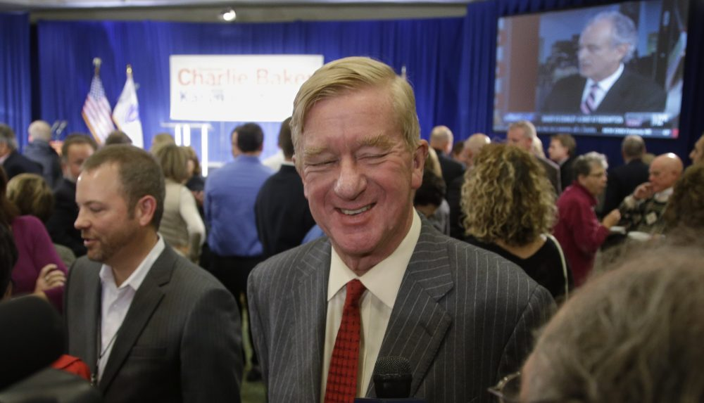 Former Massachusetts Gov. Bill Weld smiles as he talks to a reporter at a 2014 event. (Stephan Savoia/AP)