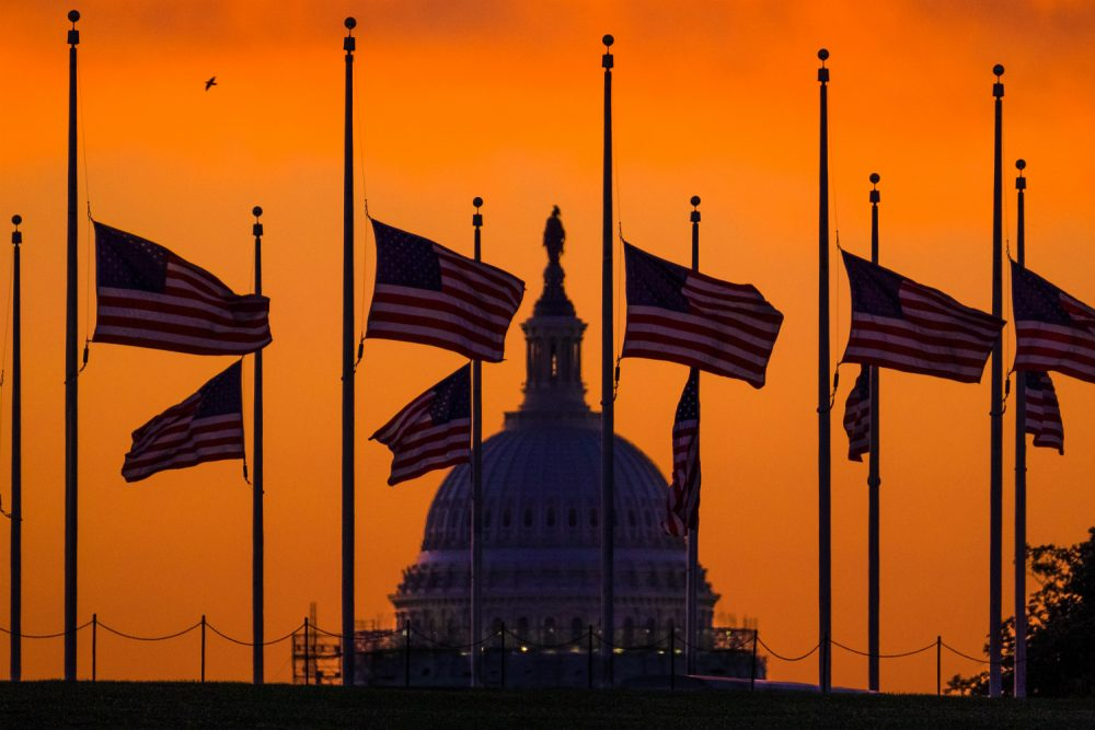 Erika Fine responds, in verse, to the the deadliest mass shooting in U.S. history. Pictured: Flags fly at half-staff around the Washington Monument at daybreak in Washington with the U.S. Capitol in the background Monday, June 13, 2016. President Barack Obama ordered flags lowered to half-staff to honor the victims of the Orlando nightclub shootings. (J. David Ake/AP.)