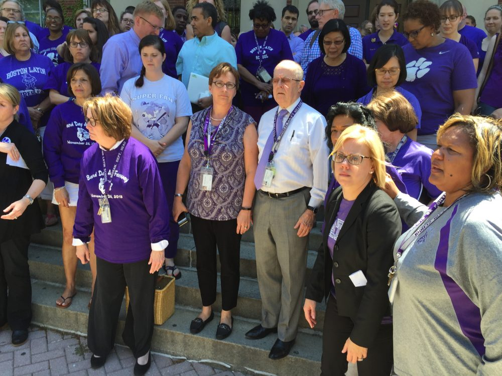 Boston Latin School Headmaster Lynn Mooney Teta and Assistant Headmaster Malcolm Flynn are stepping down after a series of racial incidents at the school. Faculty and staff gathered around them outside the school. (Lynn Jolicoeur/WBUR)
